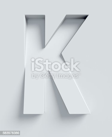 istock Letter K slanted 3d font engraved and extruded from surface 583978386