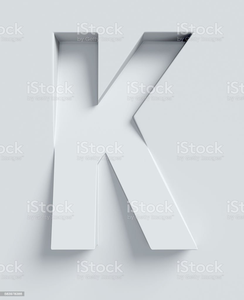Letter K slanted 3d font engraved and extruded from surface stock photo