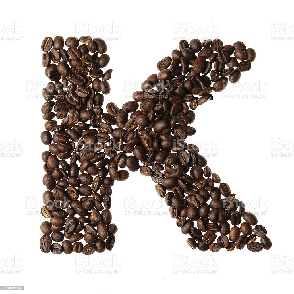 Letter K written with coffee royalty-free stock photo