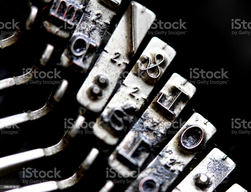 Letter & Key ampersand inside an old mechanical typewriter Itali royalty-free stock photo