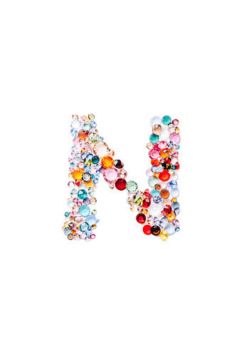 Letter N made from beautiful glass bright gems or crystals on isolated white background
