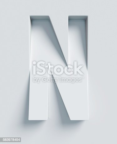 istock Letter N slanted 3d font engraved and extruded from surface 583978454