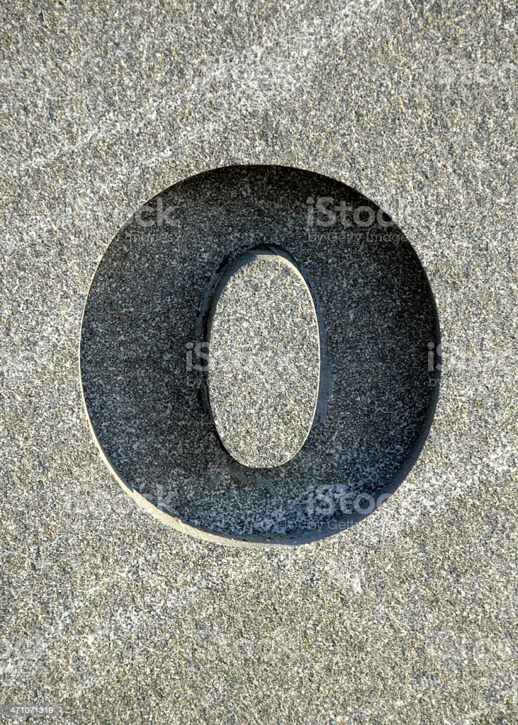 Letter O carved into stone stock photo