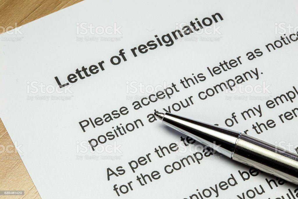 Letter of resignation silver pen stok fotoğrafı