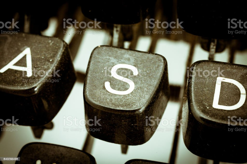 S  letter on a vintage typewriter keyboard stock photo