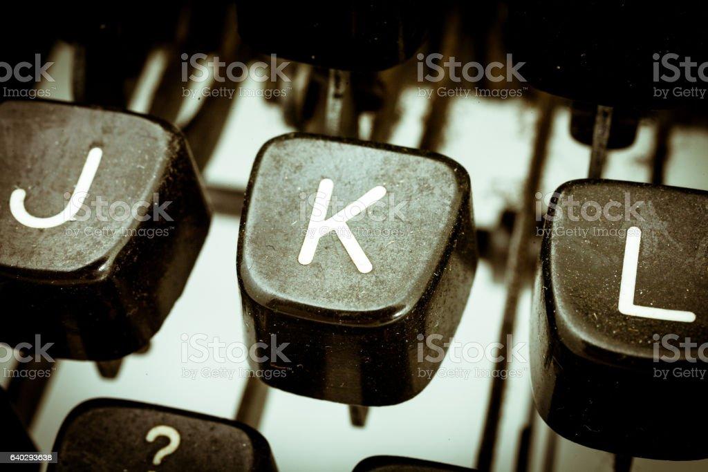 K letter on a vintage typewriter keyboard stock photo