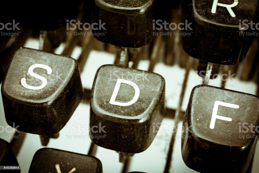 D letter on a vintage typewriter keyboard stock photo