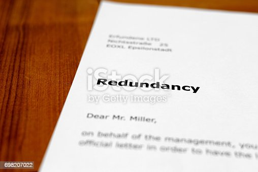 A letter on a wooden table - redundancy