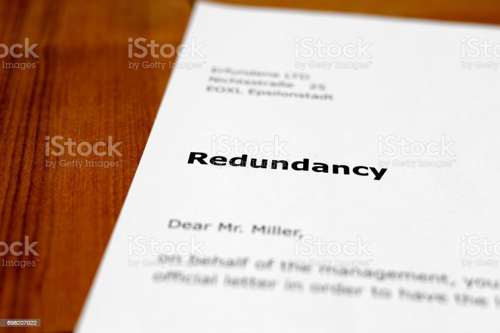 A letter on a wooden table - redundancy stock photo