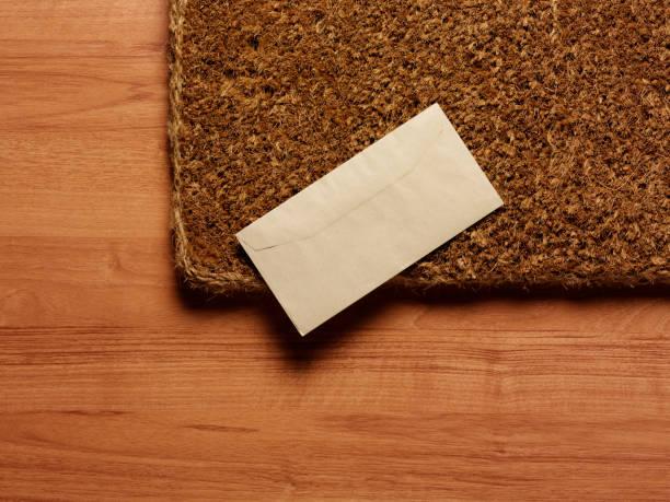 Letter on doormat stock photo
