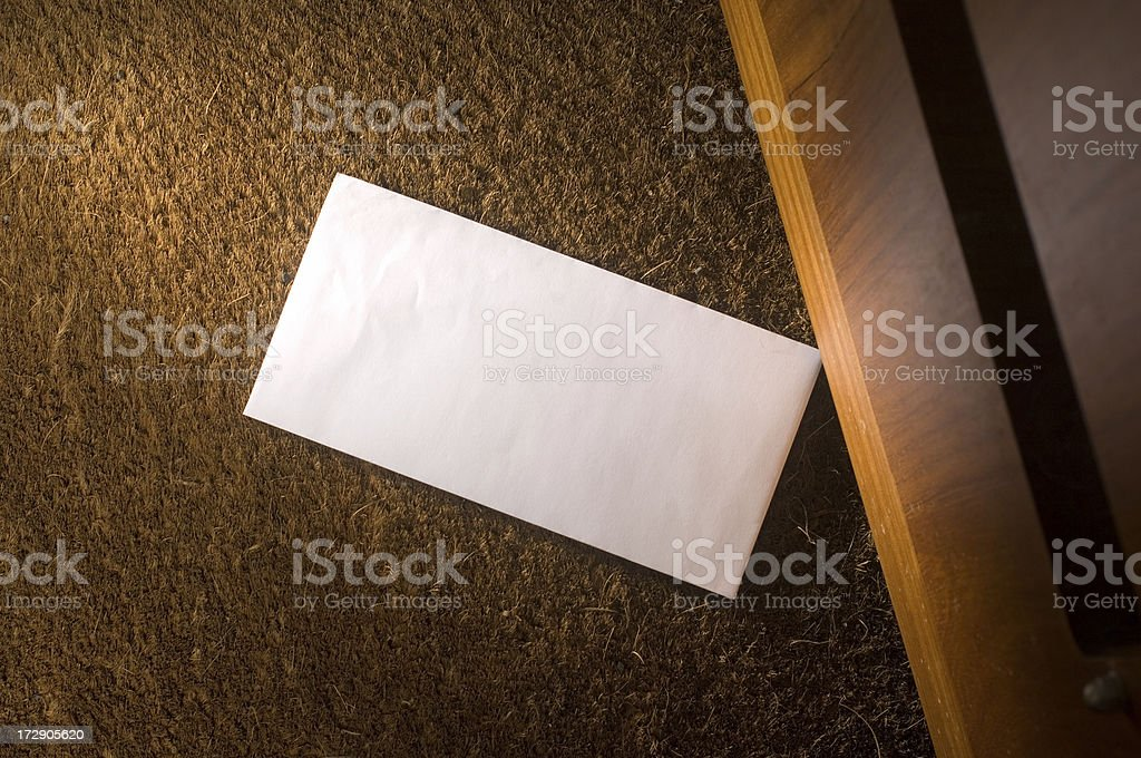 letter on the doormat stock photo