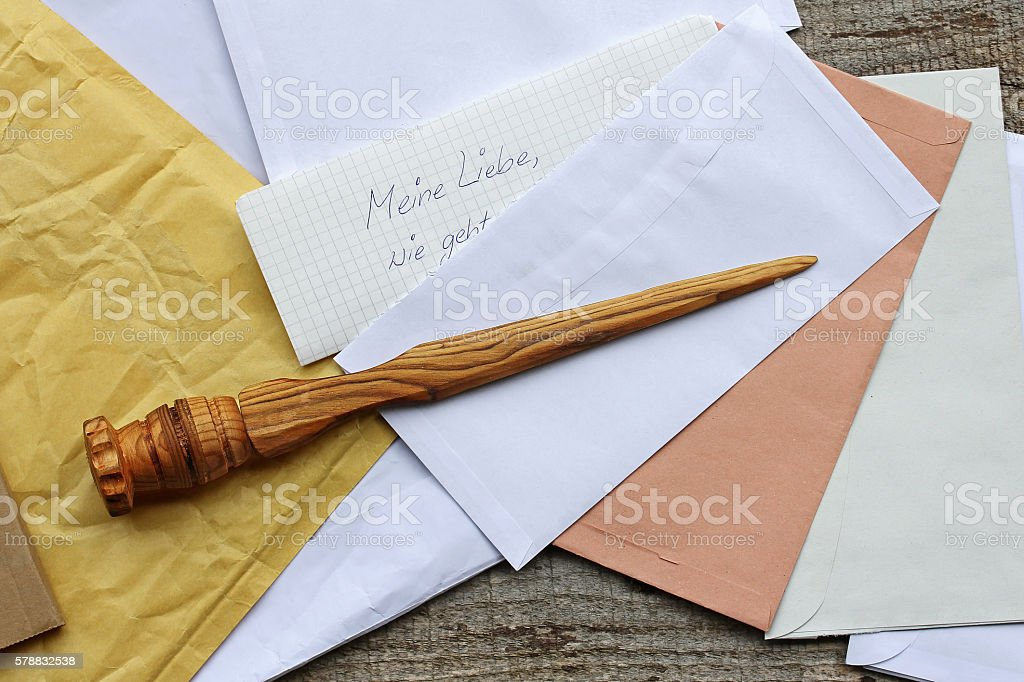 letter opener in wood and open mail stock photo