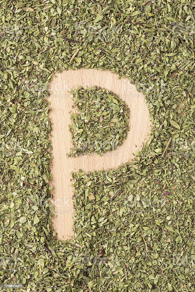 Letter P written with oregano royalty-free stock photo