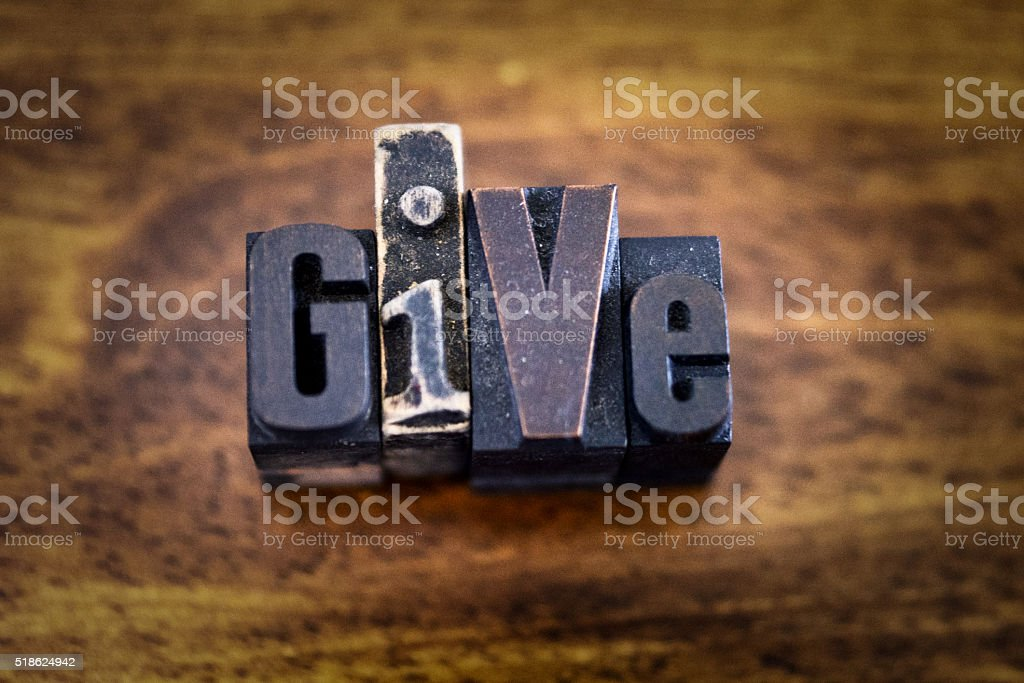 Letter Press Blocks spelling the word Give stock photo