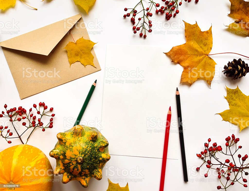 Letter, pumpkins, autumn leaves, Top view on white stock photo