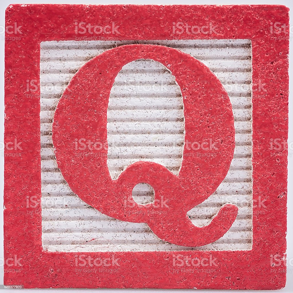 Letter Q old wood painted block stock photo
