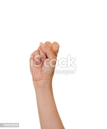 Caucasian female making the letter S using American Sign Language.