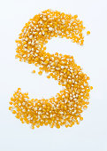 Letter S made with corn seeds.