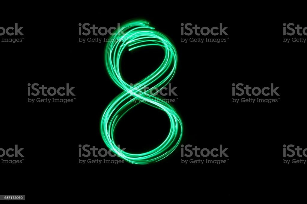 Letter Series - Number 8 - Green Light Painting Photography against a black background stock photo