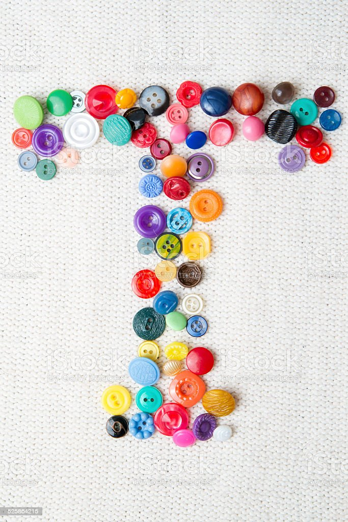 Letter T of the alphabet of buttons stock photo