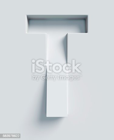 istock Letter T slanted 3d font engraved and extruded from surface 583978622