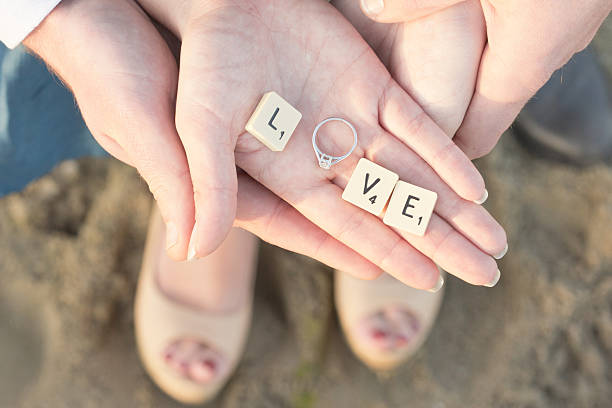 Letter Tiles and Engagement Ring in Hand stock photo