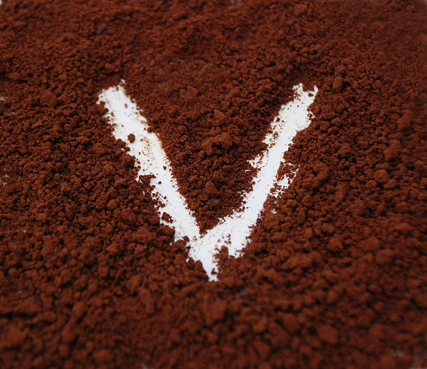 Letter V on a coffee background stock photo
