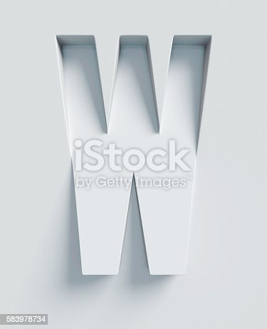 istock Letter W slanted 3d font engraved and extruded from surface 583978734