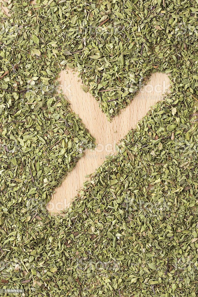 Letter Y written with oregano royalty-free stock photo