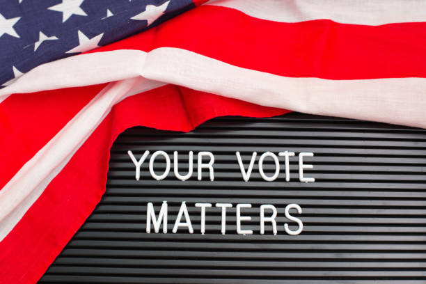 Letterboard sign with the words YOUR VOTE MATTERS with American flag stock photo