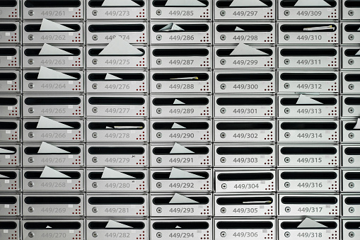 istock Letterboxes and bills with letters, with room number 812925536