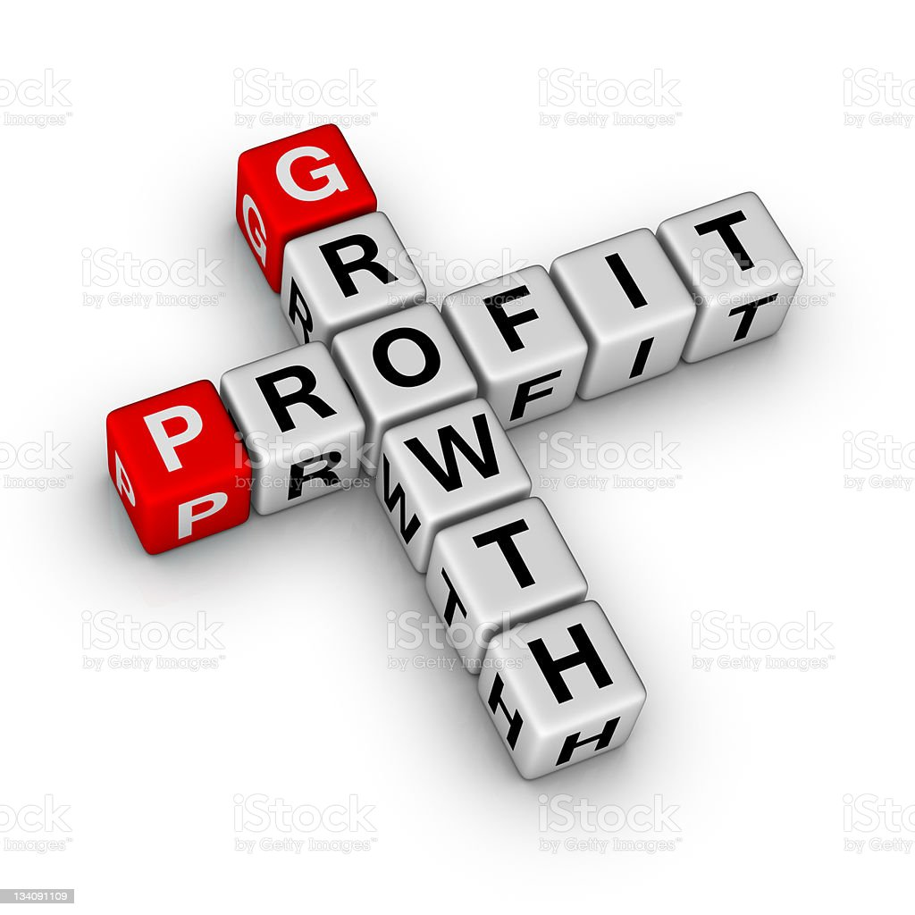 Lettered dice spelling out growth and profit in crossword stock photo