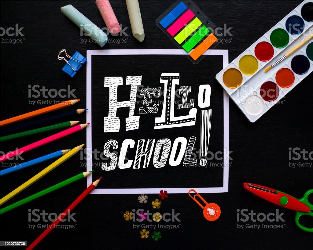 Lettering Hello, School on blackboard. Trendy concept. stock photo