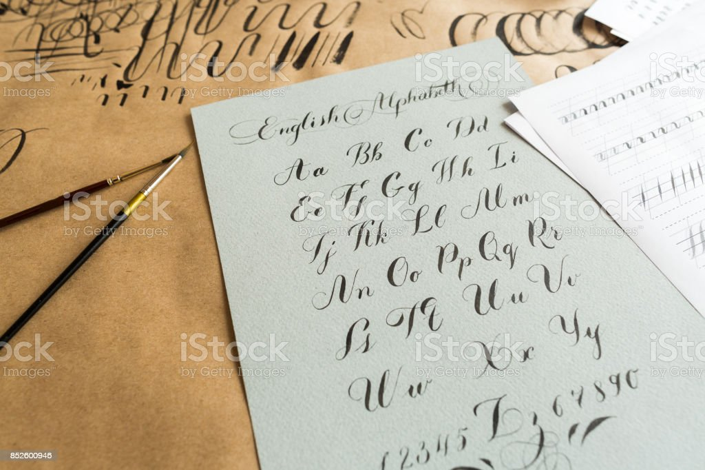 lettering, technique, drawing concept. english alphabeth written in italic style with elegant and smooth lines maded with help of thin tip of the brush and black ink stock photo