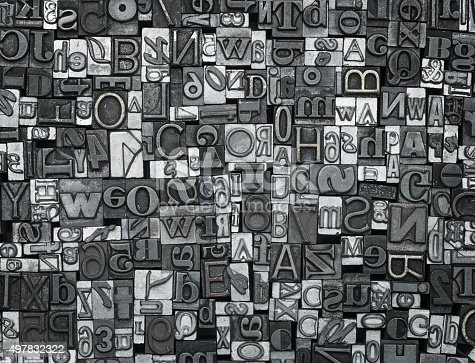 Close up of many old, random metal letters with copy space