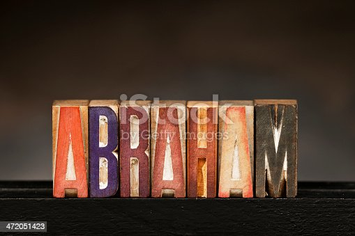 The word ABRAHAM spelled out with vintage letterpress wood block letters.
