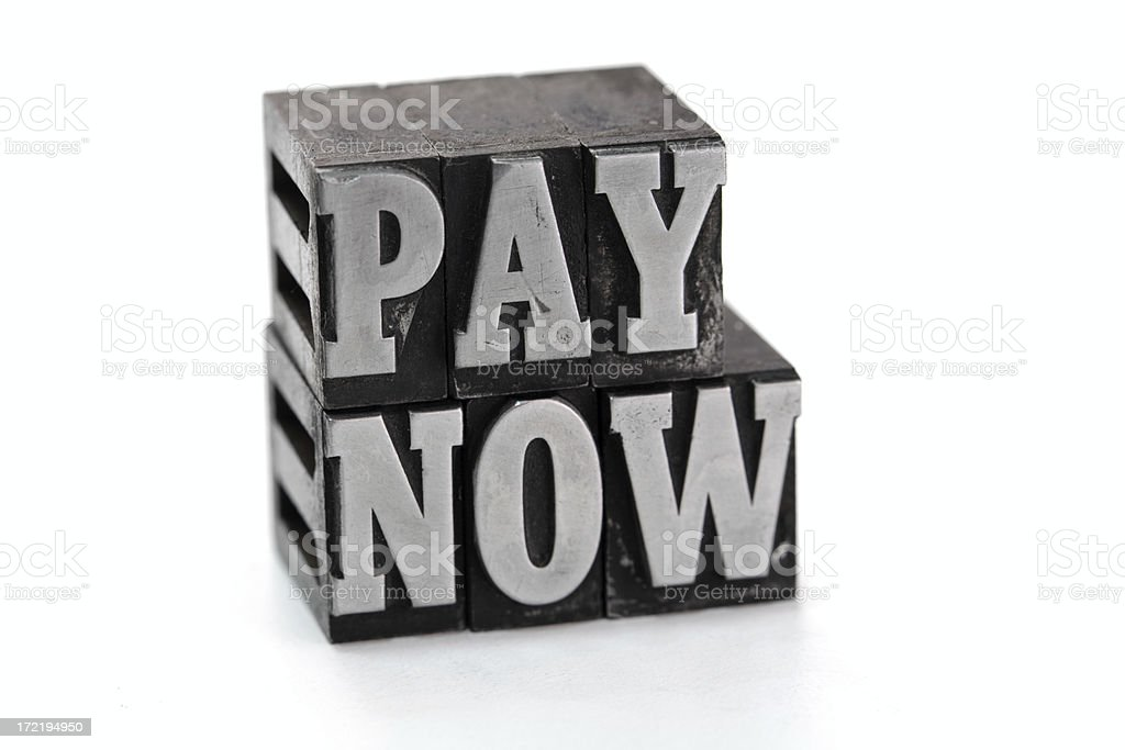 PAY NOW  letterpress royalty-free stock photo