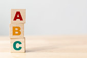 istock ABC letters alphabet on wooden cube blocks in pillar form on wood table 1192477374