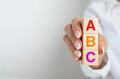 istock ABC letters alphabet on wooden 1266334560