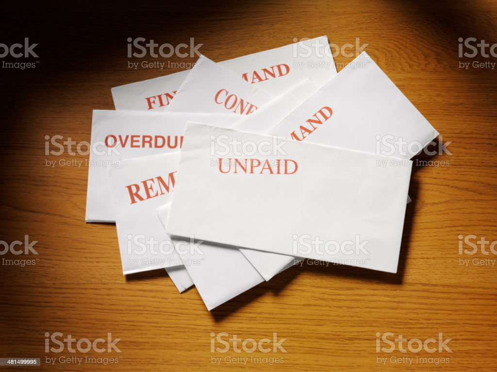 Letters and Bills on a Wooden Desk royalty-free stock photo