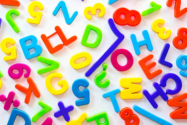Letters and numbers of different colors stock photo