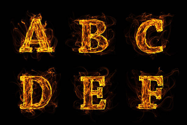 Letters Burning In The Fire stock photo