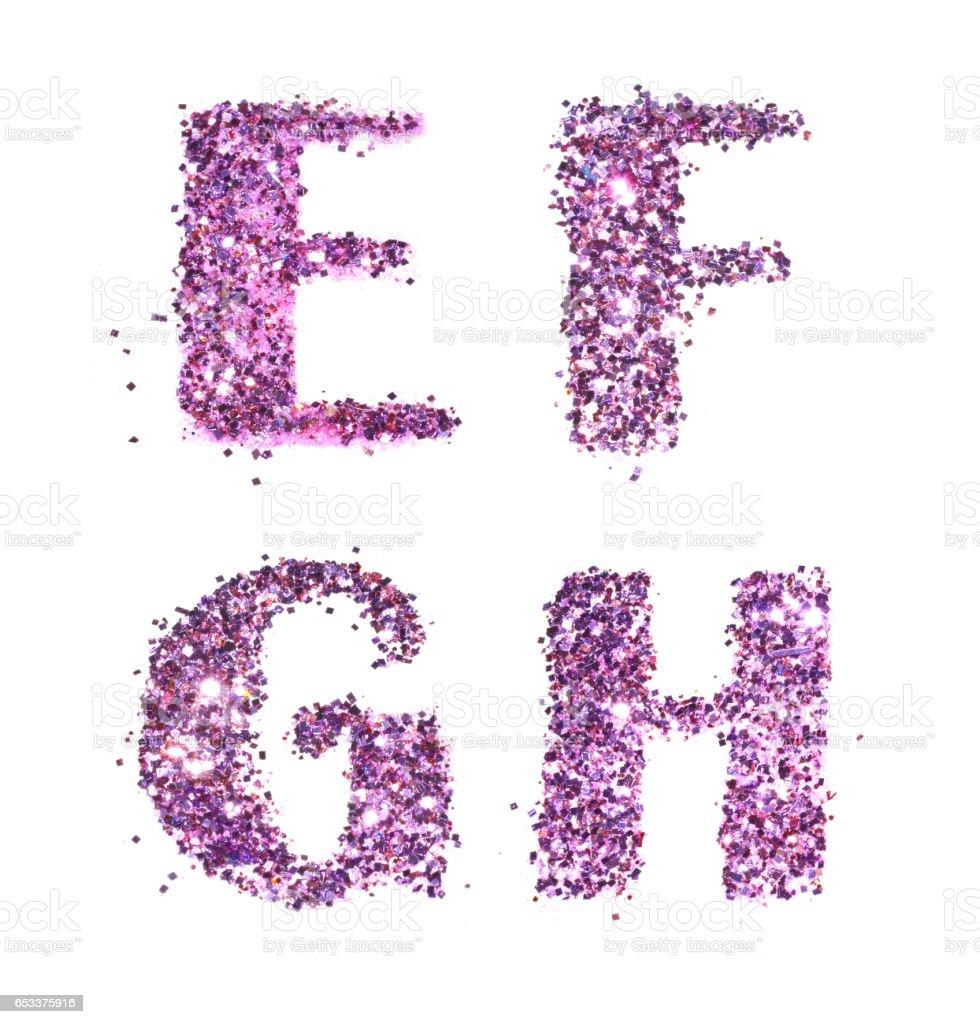 Letters E, F, G, H of purple glitter sparkle on white stock photo