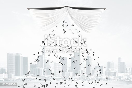 istock Letters fall from the book at city background 515315364