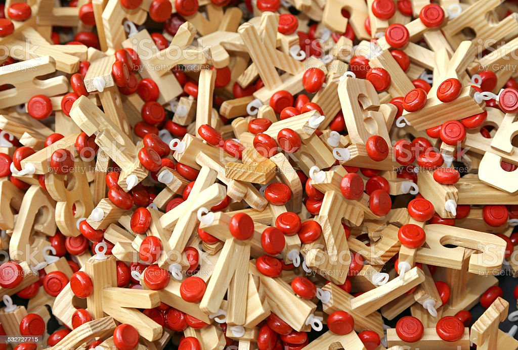 letters in wood with Red wheels to compose words stock photo