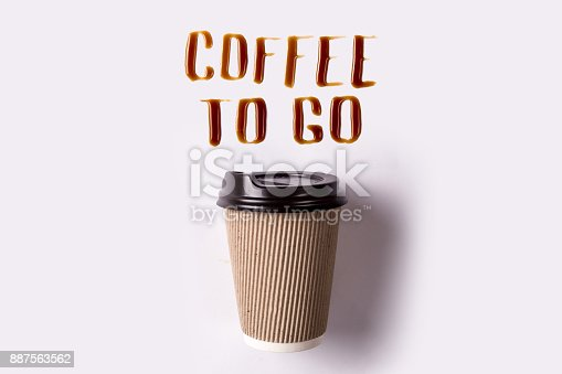 Letters of spilled coffee. Paper cup and coffee take-out. Coffee to go