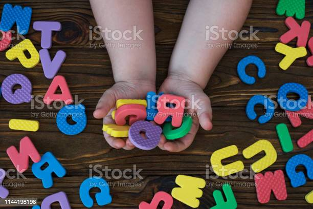 Letters of the english alphabet in his hands picture id1144198196?b=1&k=6&m=1144198196&s=612x612&h=cgi1gzdkagkwwdhyfum3udrwdi1xloilqtkvn4h6 0a=