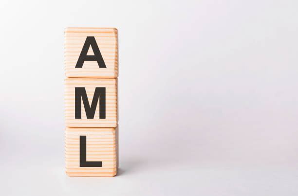 AML letters of wooden blocks in pillar form on white background, copy space stock photo