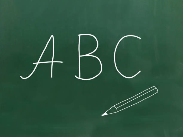 ABC - Letters on a chalkboard. The letters ABC handwritten with chalk on a green chalkboard. illiteracy stock pictures, royalty-free photos & images