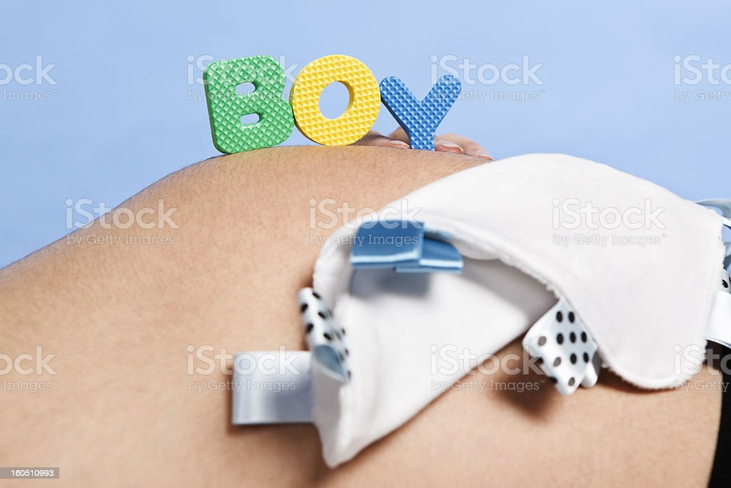 BOY letters on a pregnant belly royalty-free stock photo